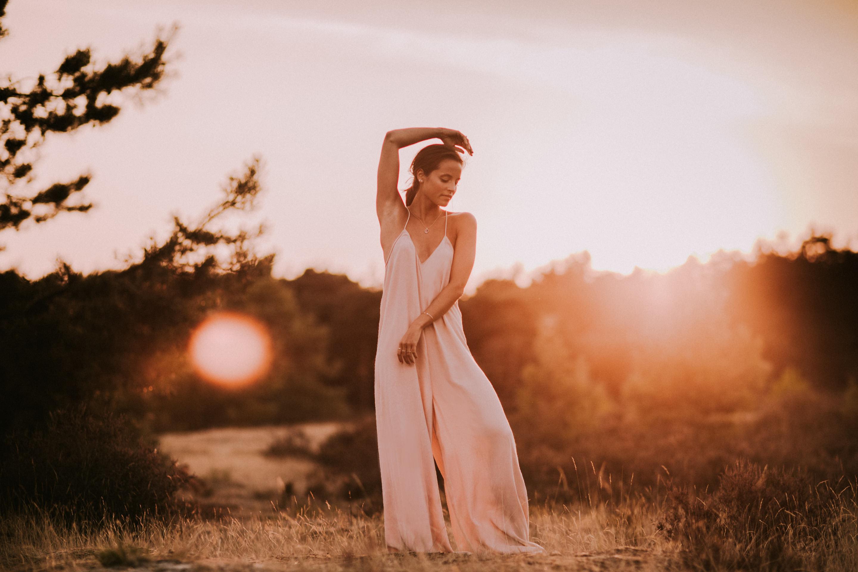 girl dancing in the golden sun