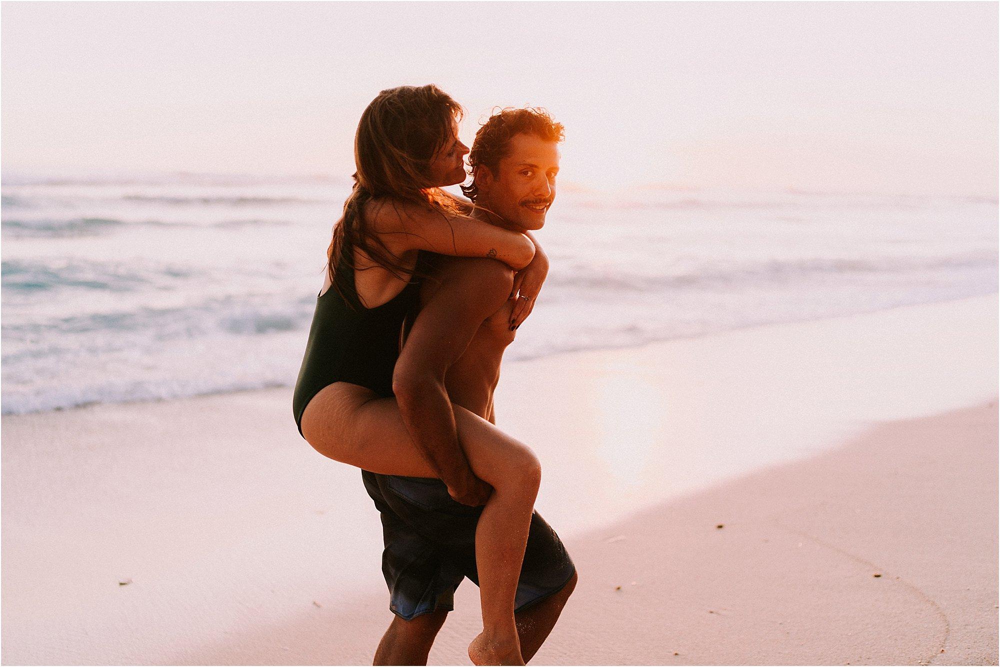couple having fun on Nyang Nyang Beach in bali