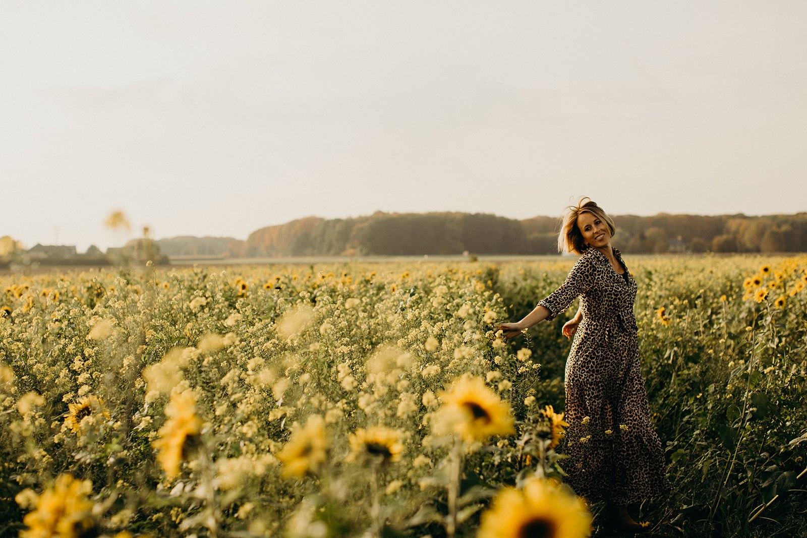 happy portrait in sunflowers